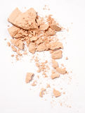 Face powder. Crushed face powder over white background royalty free stock image