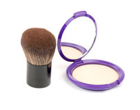 Face powder with kabuki brush Royalty Free Stock Images