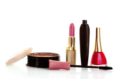 Face powder, mascara, lipstick and nail polish Royalty Free Stock Images