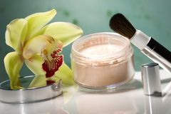 Face powder and orchid flower Royalty Free Stock Image