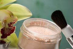 Face powder and orchid flower Stock Photos