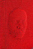 Face pressed to red pin art board.  Stock Images