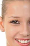 Face of a pretty young woman. Close-up of the face of a pretty smiling woman Royalty Free Stock Images