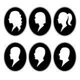 Face in profile white on a black background. Male and female faces in profile white on black oval background Royalty Free Stock Photography