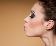 Face profile of young woman funny teen girl on brown Stock Photos