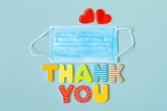 Face protective mask, hearts and wooden letters words THANK YOU