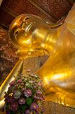 Face of Reclining Buddha gold statue in Bangkok, Thailand Stock Photo
