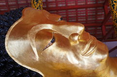 Face of Reclining Buddha statue in Thailand Royalty Free Stock Photography