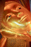 Face of Reclining Buddha,and thai art architecture. Stock Photo