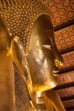Face of the Reclining Buddha at Wat Pho stock images