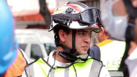 Face of a rescuer, tired, looking for more people. Alive in a collapsed buildings by the earthquake in Mexico City stock video