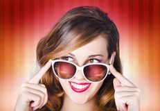 Face of a retro pinup girl in trendy sunglasses Stock Photos
