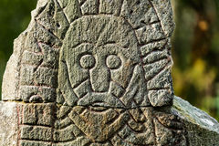 Face on a rune stone Stock Image