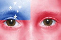 Face with samoa flag Stock Image