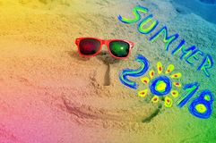 Face on the sand with the inscription sumer 2018. Creative for your time Stock Photo