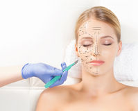 Face with a scalpel. Aging, plastic surgery concept Stock Image