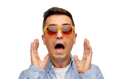 Face of scared man in shirt and sunglasses Stock Images