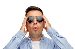 Face of scared man in shirt and sunglasses Royalty Free Stock Image