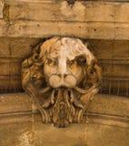 Face Sculpture on Building Facade Royalty Free Stock Photo