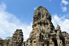 Face sculpture towers in Bayon Temple in Cambodia Stock Photos