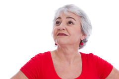 Face of a senior woman in red isolated on white background. Stock Photography
