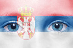 Face with serbian flag. Human`s face with serbian flag royalty free stock photos