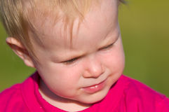 The face of serious baby closeup Stock Photography