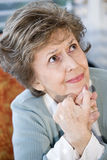Face of serious elderly woman looking up Royalty Free Stock Photo