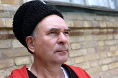 Face of a serious Kuban Cossack. On the wall background Stock Photo
