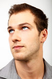 Face of serious man looking up. Over white Stock Photography