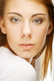 Face of a sexy beautiful young woman with clean skin on a white. Background Royalty Free Stock Photo