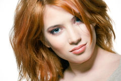 Face of a sexy redhead girl Stock Photos