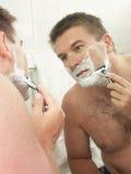 Face shaving Stock Photo