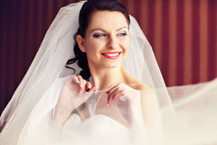 Face shines in a morning lights - bride smiles softly holding a Royalty Free Stock Photos