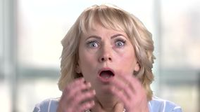 Face of shocked terrified woman.