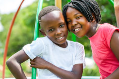 Face shot of African kids in park. Close up face shot portrait of African kids joining heads in park stock photo