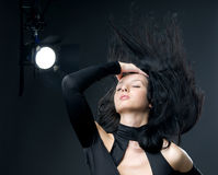 Face shot of brunette girl. With hair blowing royalty free stock photos