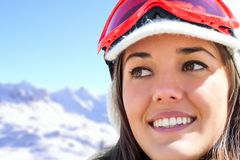 Face shot of female skier in mountains. Royalty Free Stock Photography