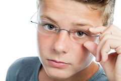Face shot og boy wearing glasses. Royalty Free Stock Photo