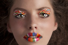 Face shot of a young girl wearing candy make up Royalty Free Stock Photo