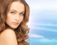 Face and shoulders of beautiful woman Stock Photos