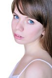 Face and shoulders of blue-eyed girl Stock Image