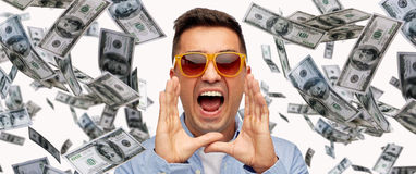 Face of shouting man with falling dollar money. Business, finance, emotions, and people concept - face of angry middle aged latin man in shirt and sunglasses Stock Photos