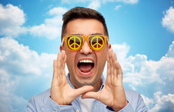 Face of shouting man in green peace sunglasses Royalty Free Stock Photo