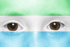 Face with sierra leone flag Stock Photo