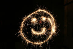 Face sign draw with firework Royalty Free Stock Photography