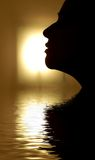 Face silhouette in rendered water. Side face in rendered water against light source Royalty Free Stock Photo