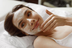 Face Skin Care. Beautiful Woman With Facial Cosmetic Mask At Spa Royalty Free Stock Image