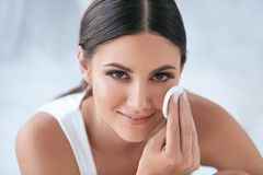 Face Skin Care. Beautiful Woman Removing Makeup With Cotton Pad stock photography