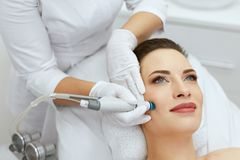 Face Skin Care. Closeup Of Woman Face Cleansing At Cosmetology. Beauty Procedure For Deep Skin Cleansing With Hydro Vacuum. High Resolution royalty free stock images